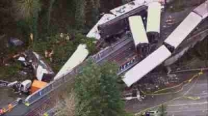 Several Killed As Train Derails, Dangles Over Highway